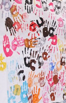 Photograph of coloured hand-prints taken at the 350 event in Crediton in 2009