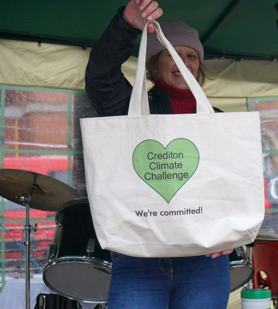 Photograph of a tote bag labelled: Crediton Climate Challenge - We're committed